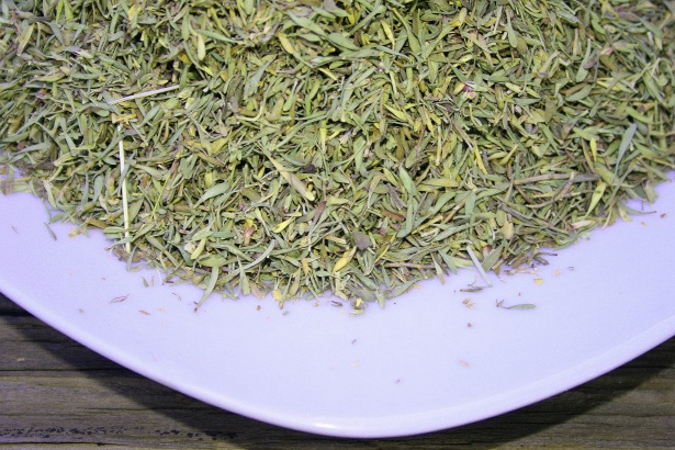 dried-herbs-on-white-plate